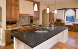 White Kitchen Island with Dark Counters, Wood Cabinets