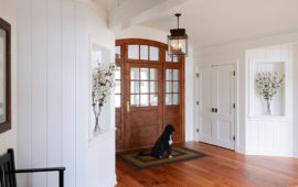 Home Entryway with White Wood Panel Walls