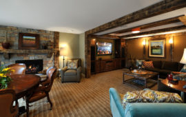 Lower Level Entertainment Area with Built-Ins and Rustic Wood Trim