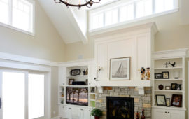 Family Room with fireplace built-ins and high windows