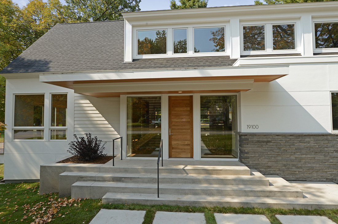 White Home Exterior with Wood Door