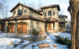 MN Home with Clay Tile Roof, Wood Garage Doors