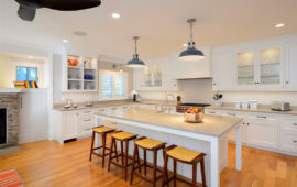Kitchen with White Cabinets Wood Floors Gray Countertops