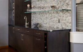 Wet Bar Black Cabinets Glass Shelves Gray Backsplash