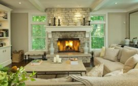 Living Room with Large Stone Fireplace and Mantel by Lake Country Builders